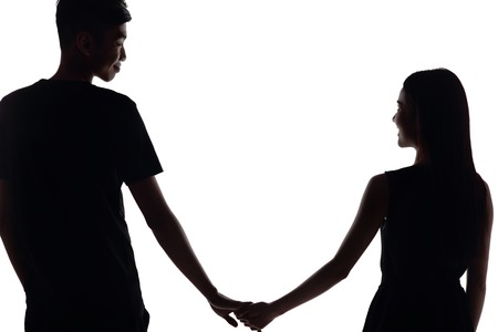 lover: silhouette of two lovers. Isolated on white background