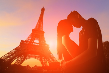 girls night: silhouette of romantic lovers with eiffel tower in Paris with sunset