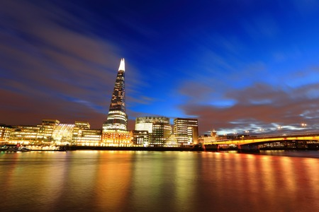 shard of glass: Cityscape of London business building skyline at night, United Kingdom, uk