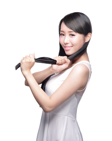 asian style: Beautiful Woman touch her health long straight hair care with smile face, asian beauty model