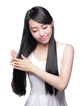 happy asian people: Beautiful Woman touch her health long straight hair care with smile face, asian beauty model