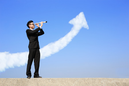 Business man with telescope ( spyglass ) looking forward with growth arrow cloud photo