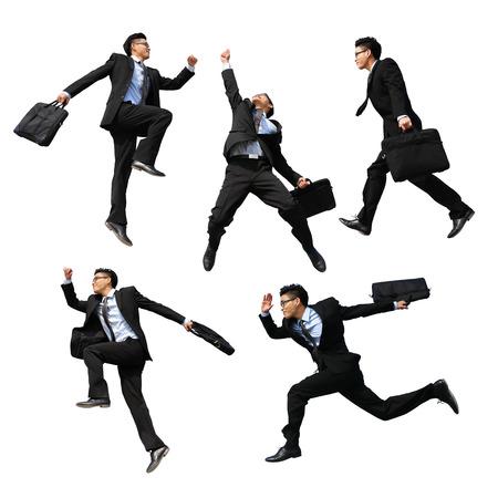 成功するビジネス人ジャンプし、白い背景と分離して実行
