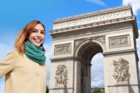triumphe: Happy woman travel at Arc de Triomphe in Paris