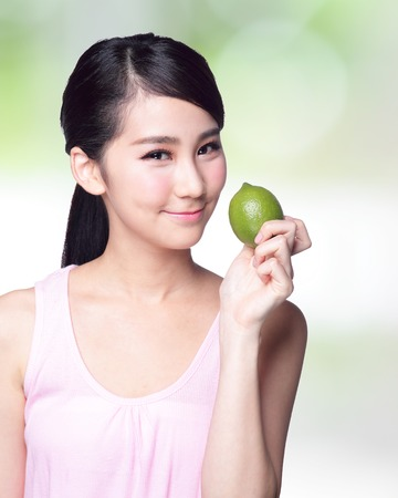 Healthy girl show lemon with smile face photo