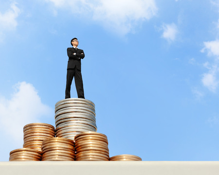 win money: I want be rich - Successful business man stand on money with blue sky, asian male Stock Photo