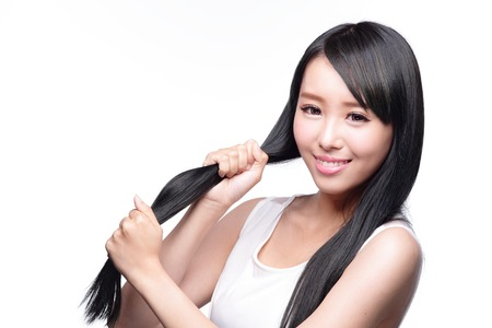 rinse: Beautiful Woman touch her health long straight hair care with smile face, asian beauty model