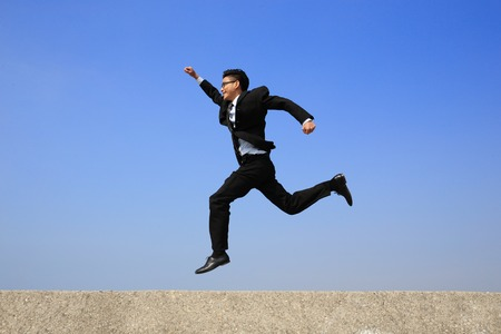 full suit: business man jump and run with blue sky background, full length, asian male