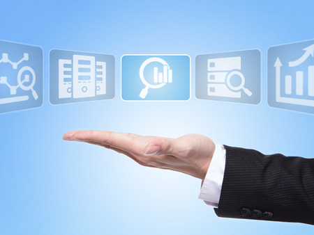 data center: data science concept , business man hand palm holding all kinds of icon about data science with blue background Stock Photo