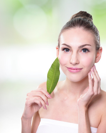 skin care woman: Skin care woman face with green leaf, concept for skin care or organic cosmetics, caucasian
