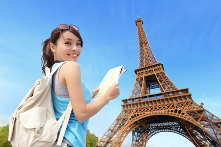 Happy travel woman in Paris with Eiffel Tower and she look map, asian beauty