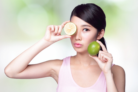 cover girls: Health girl show lemon with smile face, health food concept, asian woman beauty Stock Photo