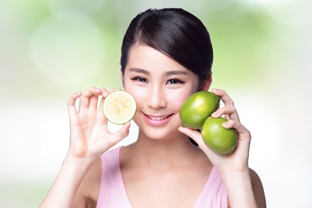 beautiful salad: Health girl show lemon with smile face, health food concept, asian woman beauty Stock Photo