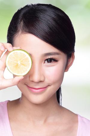Health girl show lemon with smile face, health food concept, asian woman beauty photo
