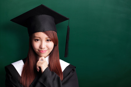 Smile student woman graduating with chalkboard