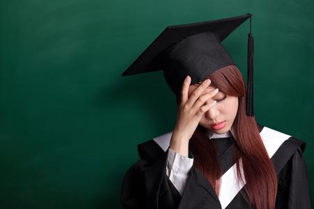 academic robe: unhappy sad student woman graduating with chalkboard