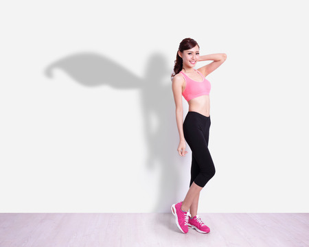 slim tummy: Superhero Sport Woman with white wall background, great for your design or text, asian beauty