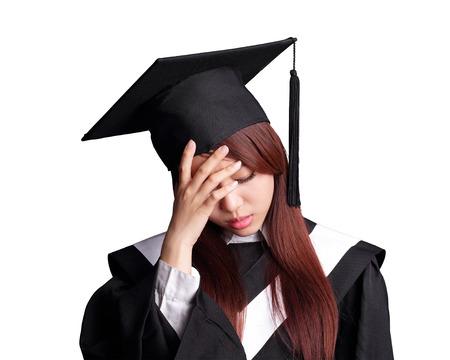 academic robe: unhappy sad student woman graduating isolated on white background, asian beauty Stock Photo