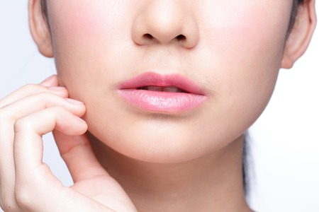 Close up portrait of young woman with beautiful lips 스톡 콘텐츠