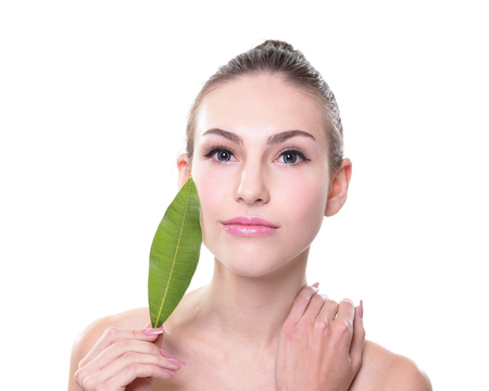 skin care woman: Skin care woman face with green leaf Stock Photo