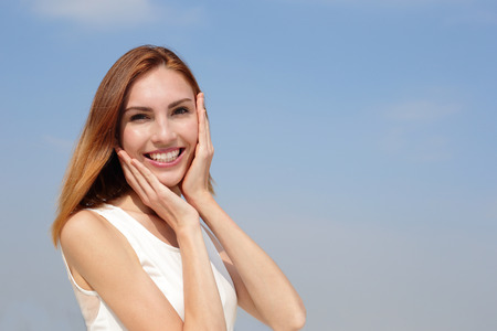Charming smile happy woman. She have health teeth and skin, great for dental care and skin care concept. caucasian beauty 免版税图像