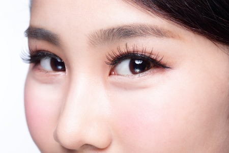 gray eyes: Beautiful woman eye with long eyelashes. asian model Stock Photo