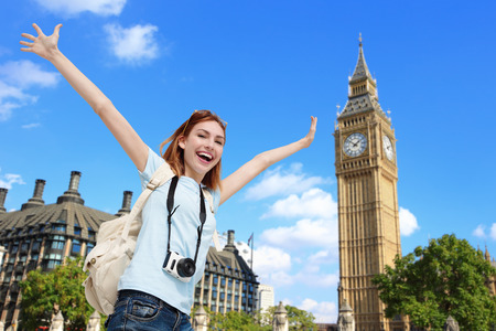 london big ben: Happy woman travel in London with Big Ben tower, caucasian beauty
