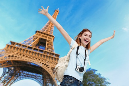 Eiffel Tower: Happy carefree travel woman in Paris with Eiffel Tower, caucasian beauty Stock Photo