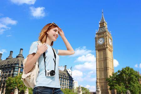 big ben tower: Happy woman travel in London with Big Ben tower, caucasian beauty