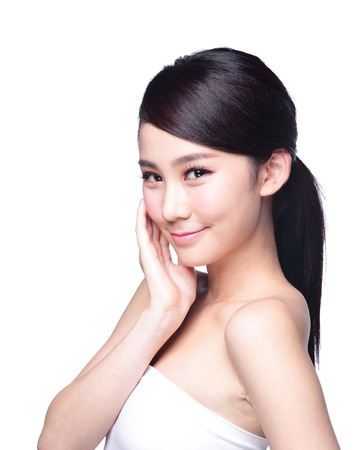 Beautiful Skin care woman Face smile to you isolated on white background. asian Beauty Standard-Bild