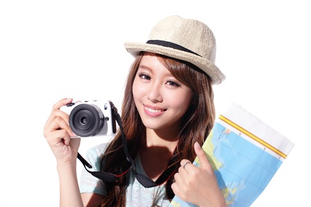 tourist tourists: Happy woman tourist travel holding camera and map isolated on white background, asian