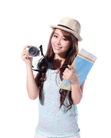 Szczęśliwa kobieta turystyka trzyma aparat i map na białym tle, asian Zdjęcie Seryjne