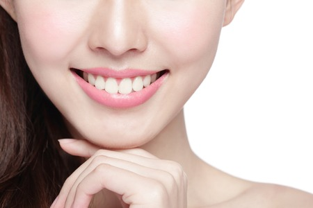 asian adults: Beautiful young woman health teeth close up and charming smile. Isolated over white background, asian beauty