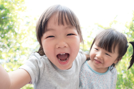 du lịch: Chúc mừng con hãy selfie trong công viên, asian