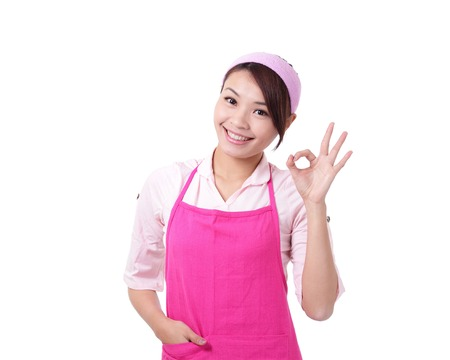 asia women: Happy young woman housewife mother wearing kitchen apron and showing OK, asian