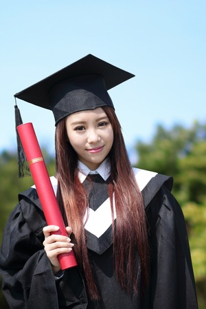 graduating: Smile student woman graduating in the campus, asian beauty Stock Photo