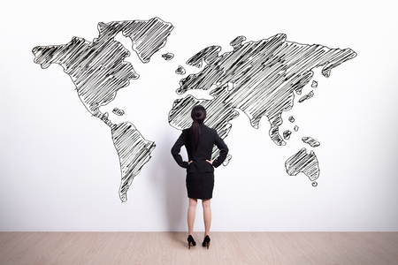 Back view of business woman look hand drawing world map, asian