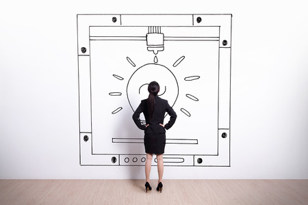 rear view girl: Back view of business woman look hand drawing 3D printer white wall background, asian