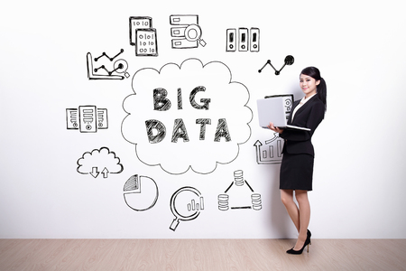 Big Data concept - business woman using laptop computer with hand drawing Big Data concept background Stock Photo