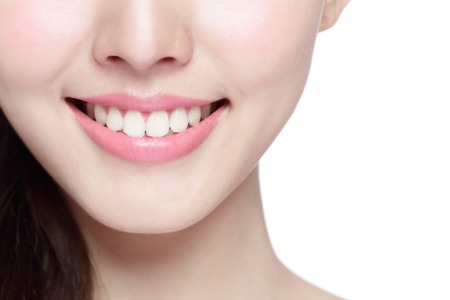 clean teeth: Beautiful young woman health teeth close up and charming smile. Isolated over white background, asian beauty