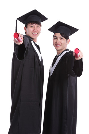 academic robe: Two happy graduates student isolated on white background, asian Stock Photo