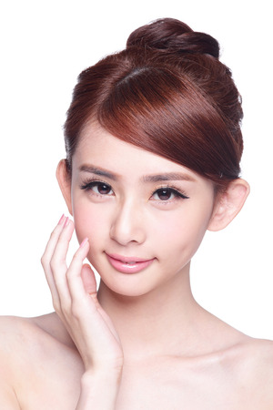 and in asia: Beautiful Skin care woman Face smile to you isolated on white background. asian Beauty Stock Photo