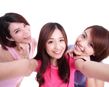 student travel: Selfie - Happy teenagers woman taking pictures by themselves isolated on white background, asian Stock Photo