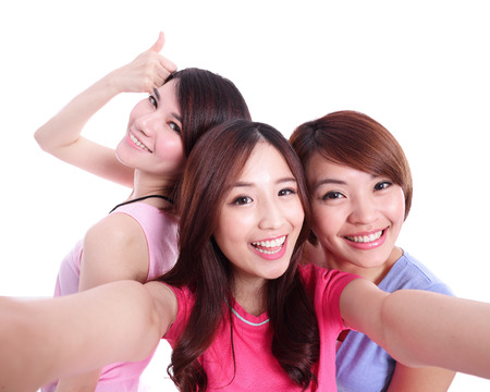 Selfie - Happy teenagers woman taking pictures by themselves isolated on white background, asian Stock Photo