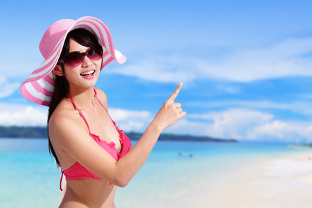 beauty in nature: Happy girl wear bikini at sea beach and smile to you, asian beauty Stock Photo