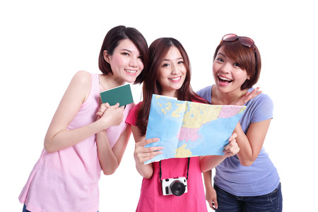 Happy group travel women hold camera, passport and map. Isolated on white background, asian photo