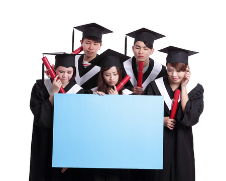 academic robe: group of graduates student think their future and show blank billboard isolated on white background, asian Stock Photo