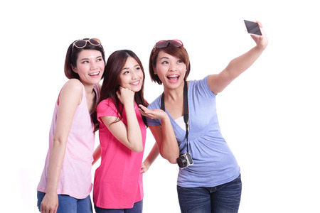 3 people: Selfie - Happy teenagers woman taking pictures by themselves isolated on white background, asian Stock Photo