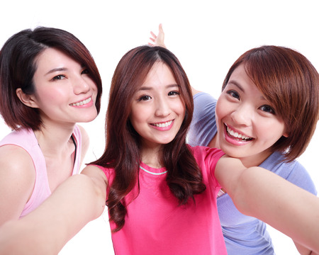 asia women: Selfie - Happy teenagers woman taking pictures by themselves isolated on white background, asian Stock Photo