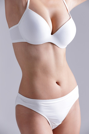person woman: Beautiful slim body of woman isolated on gray